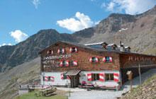 Foto: Tirol Werbung / Wander Tour / Adlerweg Etappe 69 - Serpentinen-Tanz ins Tal / Innsbrucker Hütte / 13.08.2007 15:27:04
